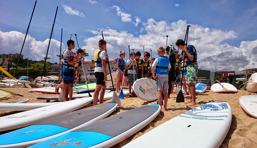 classes de paddle surf per grups